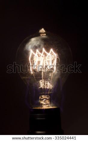 Decorative antique edison style light bulb in dark room #335024441
