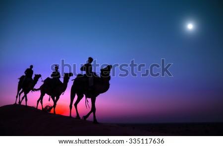 Indigenous Indian Man Riding Through Desert Camel Concept #335117636