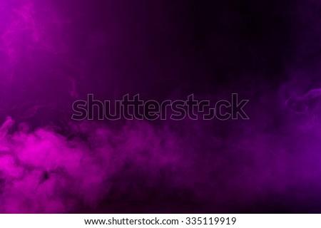 Swirling pink/magenta/purple fog on hazy dark background.  Royalty-Free Stock Photo #335119919