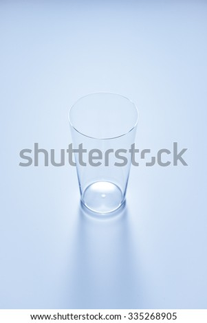 clean simple empty glass in soft blue color #335268905