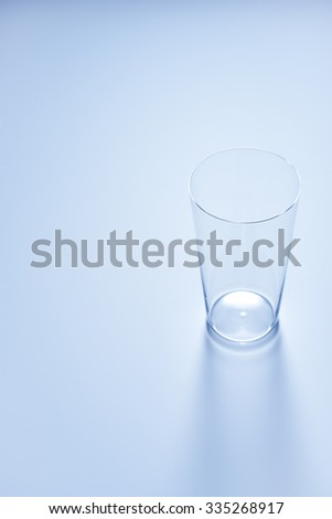 clean simple empty glass in soft blue color #335268917