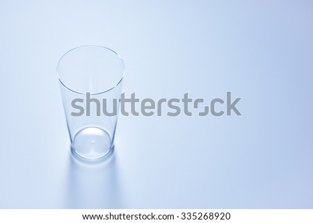 clean simple empty glass in soft blue color #335268920