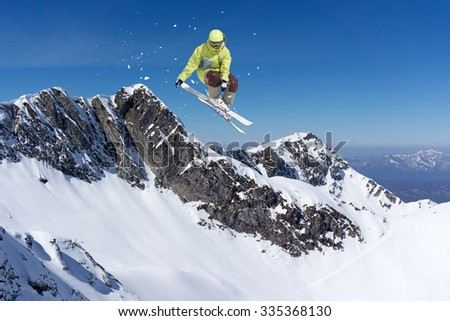 Flying skier on mountains, winter extreme sport #335368130