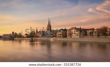 View on Church of the Holy Cross and St. Bartholomew, Odra river and Tumski Island, Wroclaw, Poland Royalty-Free Stock Photo #335387726
