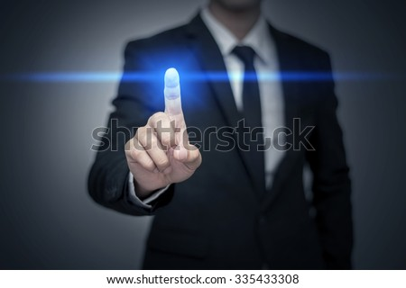 Close up of businessman touching digital screen with finger #335433308