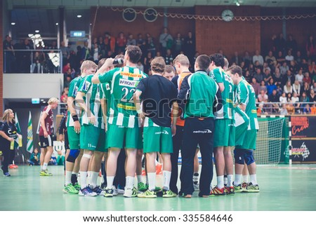 STOCKHOLM, SWEDEN - NOV 4, 2015: Hammarby players during a time out in the Handball game between Hammarby vs Lugi at Eriksdalshallen. Allsvenskan Swedish leugue #335584646