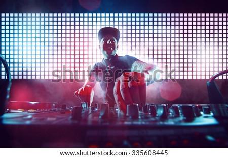 DJ on Turntables Royalty-Free Stock Photo #335608445
