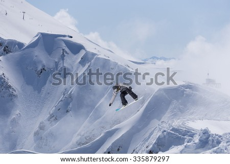 Flying snowboarder on mountains, extreme winter sport #335879297