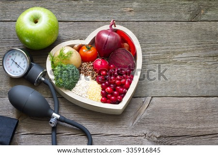 Healthy food in heart and cholesterol diet concept on vintage boards #335916845