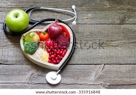 Healthy food in heart and cholesterol diet concept on vintage boards Royalty-Free Stock Photo #335916848