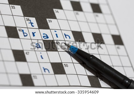 A crossword puzzle saying train and brain. An image of a pencil against an empty crossword puzzle. Crossword puzzles are excellent training for brains. #335954609