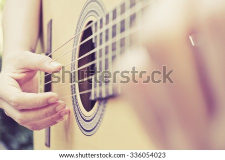 Close up image of Man playing his classic guitar background #336054023