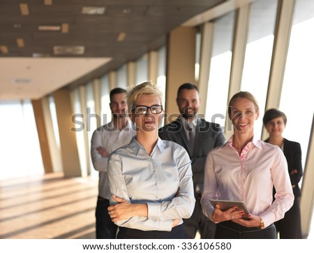 business people group standing together as team by window  in modern bright office interior #336106580