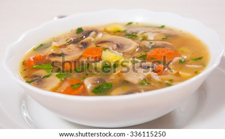 mushroom soup with rice and vegetables #336115250
