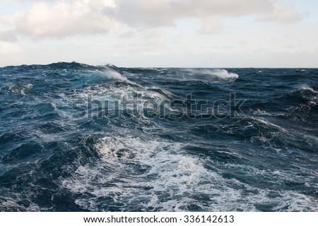 Sunny Day at Windy Seas Royalty-Free Stock Photo #336142613