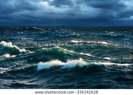 Breaking Waves at Rising Storm Royalty-Free Stock Photo #336142628