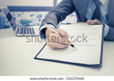 Business man signing a contract #336234668