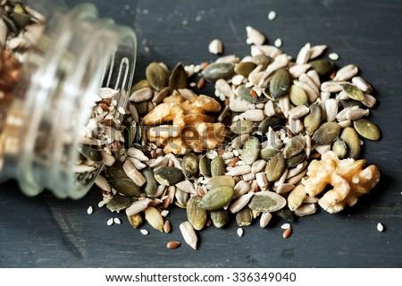 Various seeds , nuts seeds , pumpkin seeds and varies in glass jar Royalty-Free Stock Photo #336349040