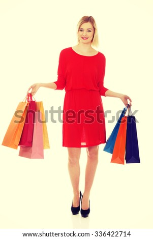 Beautiful woman with a lot of shopping bags. #336422714