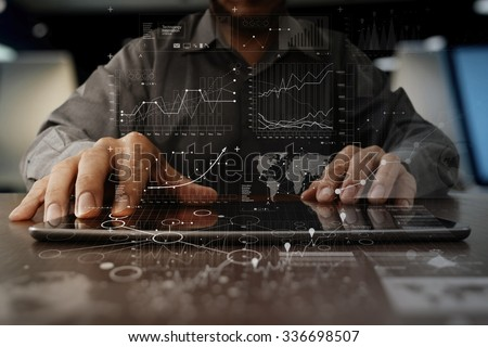 businessman hand working on laptop computer with digital layer business strategy and social media diagram on wooden desk #336698507