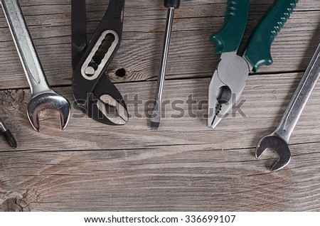 Tools for repair on a wooden background #336699107