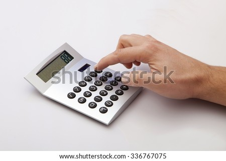 Calculating on the white Desk in the Office #336767075