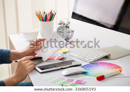 Young designer woman with beautiful hands with idea sign and tablet #336805193