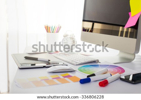 Modern office workplace with digital tablet, notepad, colorful pencils, glasses, in morning Royalty-Free Stock Photo #336806228