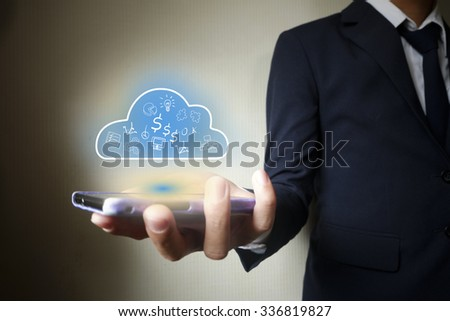 Businessman mobile holding cloud computing  in hand , business concept ,business idea #336819827