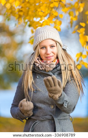 Young woman practising self defence outdoor in autumn #336908789