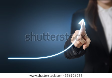 Development and growth concept. Businessman plan growth and increase of positive indicators in his business. Royalty-Free Stock Photo #336926255