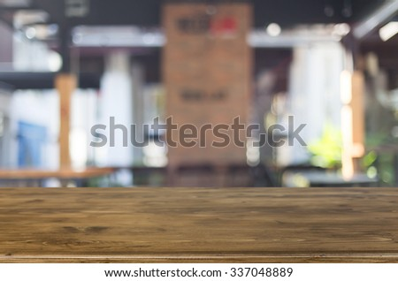 Selected focus empty brown wooden table and Coffee shop blur background with bokeh image. #337048889