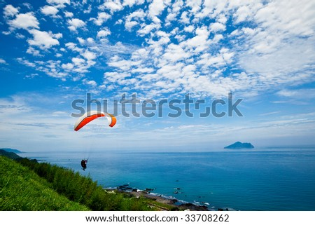 Paragliding with beautiful cloudscape background #33708262