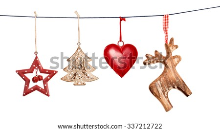 Vintage Christmas decorations hanging on string isolated on white background Royalty-Free Stock Photo #337212722