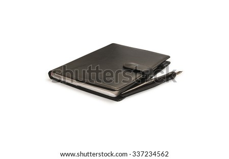 Black diary with pen on white background. #337234562