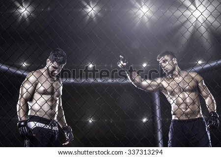 Two mma fighters inside the arena before fight Royalty-Free Stock Photo #337313294