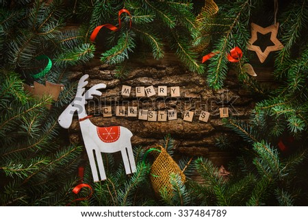 Merry Christmas. Christmas greeting card with rustic wood and ornaments. Xmas background. #337484789