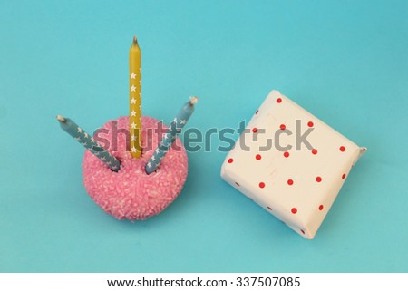 Cupcake and gift box on blue background