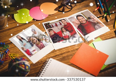 Snow against high angle view of office supplies with blank instant photos #337530137
