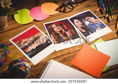 High angle view of office supplies with blank instant photos against cool dj spinning the decks #337530287