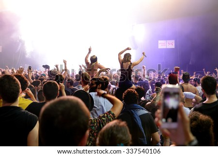BARCELONA - JUN 19: Crowd dance in a concert at Sonar Festival on June 19, 2015 in Barcelona, Spain. #337540106