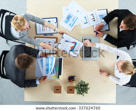 Business people sitting and discussing at business meeting, in office #337624760