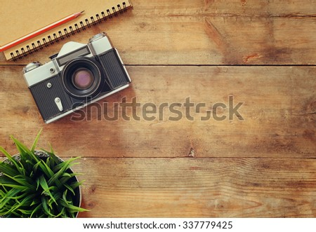 top view image of blank notebook and old camera