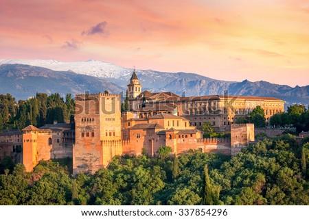 Ancient arabic fortress Alhambra at the beautiful evening time, Granada, Spain, European travel landmark #337854296