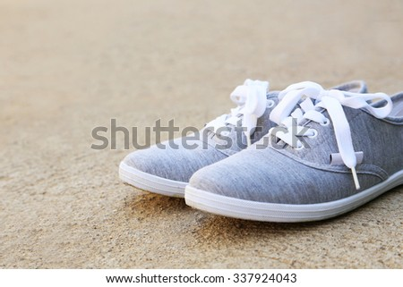 Pair of grey shoes outdoors #337924043