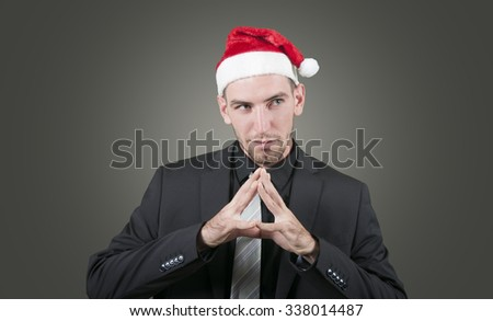 Caucasian business man thinking wearing a christmas hat #338014487