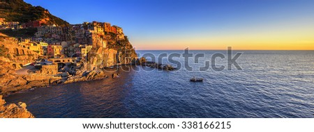 Manarola village on cliff rocks and sea at sunset., Seascape in Five lands, Cinque Terre National Park, Liguria Italy Europe. Panoramic view.