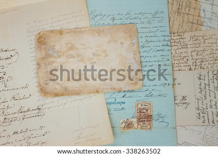Set of handwritten antique letters close up and copy sapce on empty antique paper #338263502