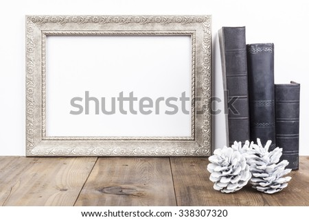 Horizontal Silver Frame With Old Books on Brown Wood Table
