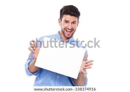 Young man with blank poster #338374916